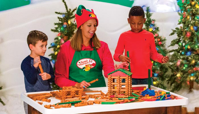 Kids playing with Lincoln Logs