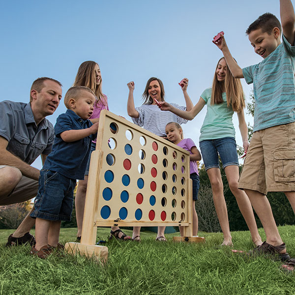 family playing yard game