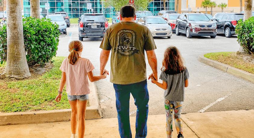 Ryan & daughters leaving the hospital