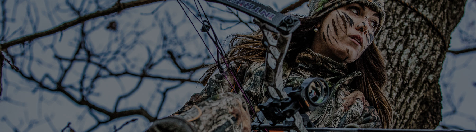 Woman in treestand