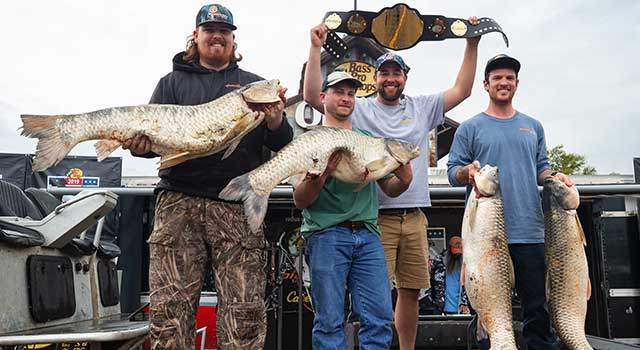 bowfishing team holds up winning fish