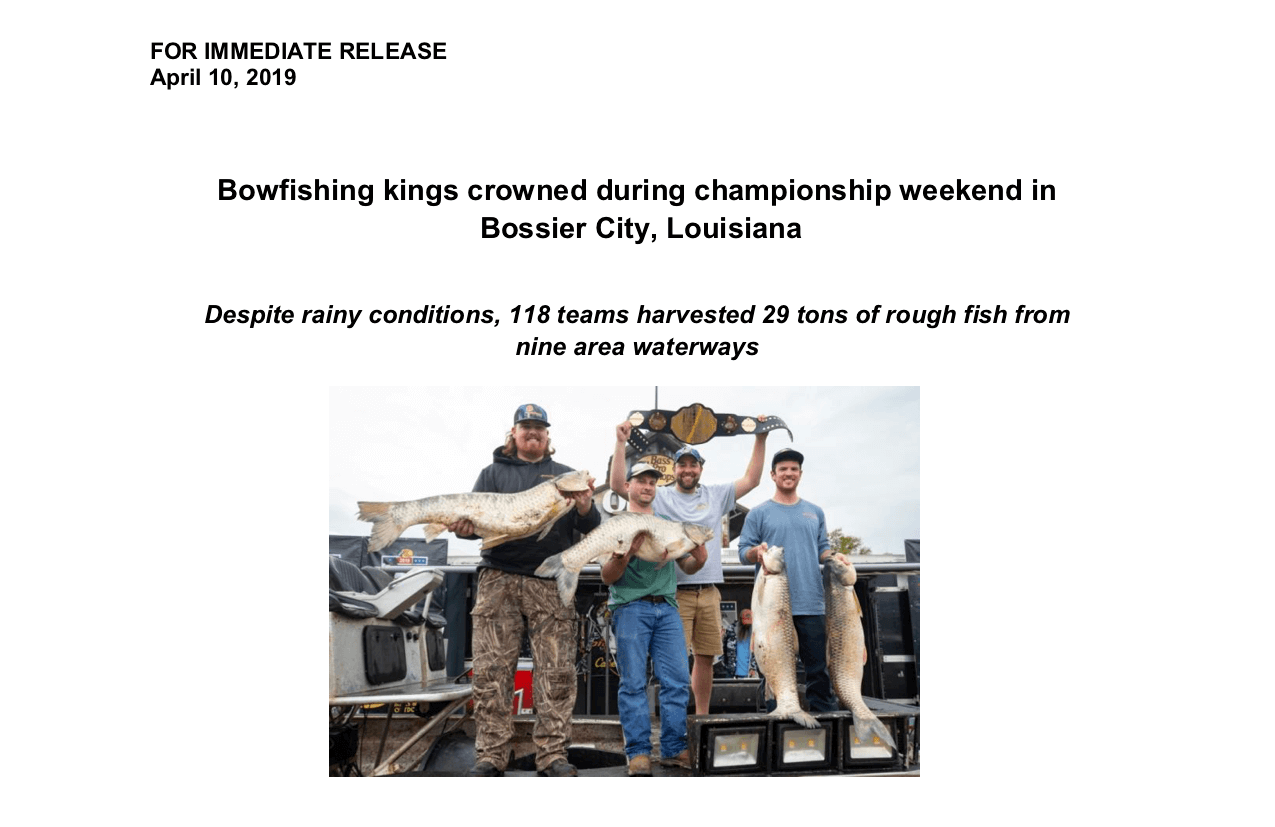 bowfishing team holding trophy fish