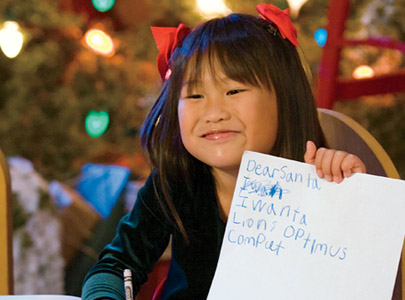 Child writing letter to Santa